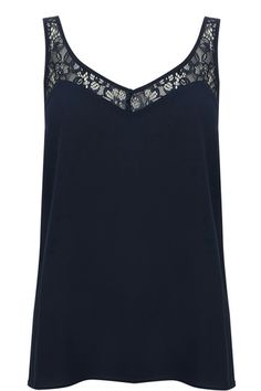 This delicate sleeveless shell top features a pretty lace insert trim and a sweetheart neckline. The piece features a v neck and a scoop on the reverse.