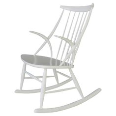 Danish Rocking Chair by Illum Wikkelsø | From a unique collection of antique and modern rocking chairs at https://www.1stdibs.com/furniture/seating/rocking-chairs/