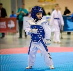 This picture of a kid at a taekwondo tournament represents what I do almost every day