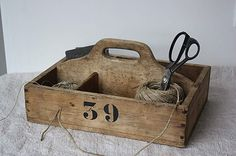Rustic Wrapping crate: Twine & brown paper rolls.