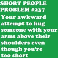Short people problem #237: Your awkward attempt to hug someone with your arms above their shoulders even though you're too short.