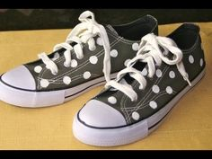 Painting polka dots on canvas shoes. So cute!