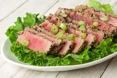 Sesame-Crusted Tuna Steaks: Restaurant-style sesame crusted tuna is a quick and easy dish to make at home and requires just a handful of ingredients. Serve with fresh salad greens, steamed rice and soy sauce and wasabi for dipping.
