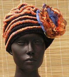 Black Crochet Hat with an OrangyPinkish Stripe by FunkyMagicalHats