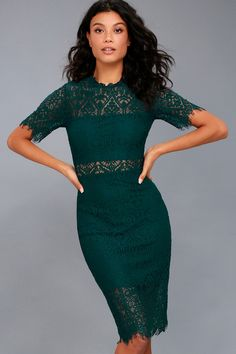 The Remarkable Forest Green Lace Dress is the perfect frock for any occasion! White lining creates a cool two-piece look beneath sheer lace as it forms a ruffled, rounded neckline, short sleeves, and a darted, sheath silhouette. Midi skirt with a sheer eyelash lace hem and hidden back zipper.