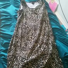 Leopard print dress 2x leopard print dress. Worn once. Been in my closet ever since. I thought I'd wear it more because it can be both a summer dress by itself or another season by adding a cardigan or jacket but I didn't find any that fit ME the right way. But I'm sure it'll be great for you ? Dresses