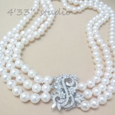 """Item no.: GSN0019-RH  925 SILVER C.Z.CLASP COLOR: SILVER (WITH RHODIUM PLATING)  PEARL (7.5-8MM) COLOR: CREAM  SIZE: 16"""""""