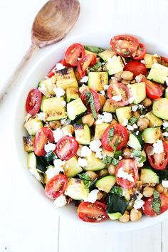 Grilled Zucchini, Chickpea, Tomato, and Goat Cheese Salad Recipe on http://twopeasandtheirpod.com This easy summer salad is healthy, delicious, and perfect for all of your summer BBQ's!