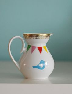 Lovebirds and bunting pitcher