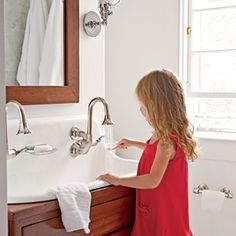 I like this double, old-fashioned Kohler sink.   Restoring a Historic Home | Authentic Update | CoastalLiving.com