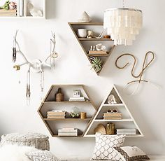 Triangular Wall Shelves : hang 2 vertically, one pointing down and one up like shown in photo - place other wall decor around the 2 triangles