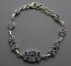 Fantastic faceted violet gemstone is set to adorn a designer silver bracelet setting. You will leave everyone spellbound by flawless sparkle of the marquise cut violet purple Amethyst gemstones set in this stunning and classy bracelet. High quality m