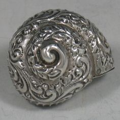 Antique Victorian sterling silver hand-chased snail pillbox made in Sheffield, 1898.