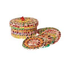Box set of six coasters handcrafted in Nepal with recycled snack wrappers #ecofriendly #handmade #fairtrade http://www.jeevankala.com/ProductDetails.asp?ProductCode=RPC%2DBOX%2DCSTR6