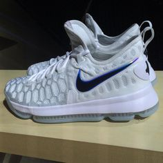 19accc3c7389 The Nike KD 9 White Black Blue features predominate White along with Black  accents and Blue hints.