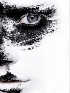 White face paint blurs out so the black paint looks like remains and the eye really stands out High-Contrast Portrait @ Busy Being Fabulous.