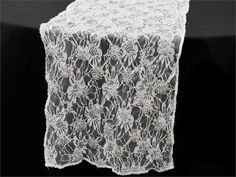 Cherubic Carnations Motif Table Runner - Silver   For creating a simply heavenly party ambiance, our Cherubic Carnations Motif table runner is an ideal choice. This divine runner features silver embroidered tulle material with silver interlaced thread designing a mesmeric floral print throughout the fabric. The enchanting fusion of cheery flowered design with shimmery silver thread embroidery imparts an empyreal touch to the table runner. Create an air of angelic magnificence at your…