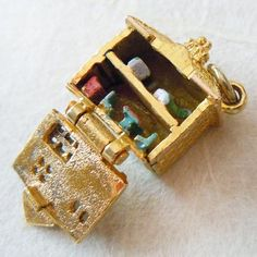 9ct Yellow Gold Dollhouse Charm, opening to enameled furniture from A Genuine Find.