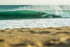 Stephanie Gilmore finding a shady spot, barrel deep in Mexico.