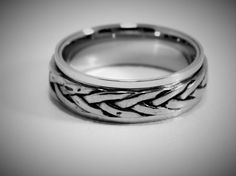 This is a stunning, hand-crafted Sterling Silver Weave Spinner Ring. Choose from High Polish, Satin, or Oxidized finish. Solid 925 sterling silver ring of great quality. Its interwoven design creates a very unique and elegant look! Makes a beautiful ring for your loved one. Suitable for Men or Women. Ring will arrive in a nice fitted jewelry box. 8mm wide  2.2mm thick Very sturdy ring! Will not bend! Spins Smoothly !!  Free Engraving is for Inside of Ring. Please include what you would like…