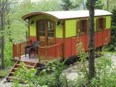 Gypsy Caravan On Wheels. $16,500. Wider than the standard Tiny House, so probably requires a special permit to tow. Everything on one floor. One bedroom, no lofts, of course. Cute, deep porch. Certainly affordable.