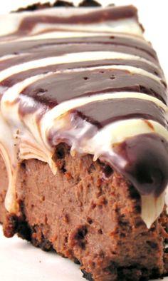 Triple Chocolate Cheesecake Recipe ~ Smooth and creamy dark chocolate cheesecake covered in white and milk chocolate toppings…. YUM!