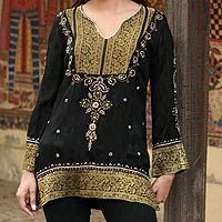 Accented with beadwork and golden embroidery, this beautiful blouse recalls splendor of Mughal art of India.