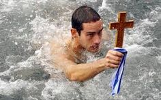 A local priest throws the cross into the cold winter waters of the beach and a group of people have to find it and bring it back to  the Church in order to have a blessing from God.