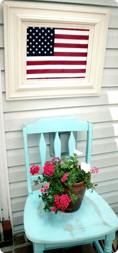 Front porch - I would paint the chair red and coordinate the lowers, but i love this look.