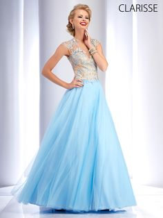 Fun and Flirty Winter Blue Ball gown 2015 Prom Dress Style 2701. Features big tulle ball gown, sexy key hole back, illusion bodice and back, sweetheart neckline, and blue floral and beaded applique. Available in sizes 0-24.
