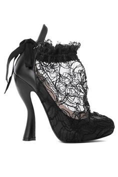Nina Ricci-These would be too cute with a black pencil skirt and white, high-collared, ruffled blouse.