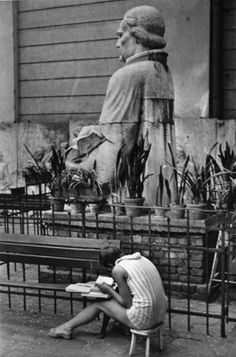 Budapest (large statue and woman reading on stool), 1971. André Kertész