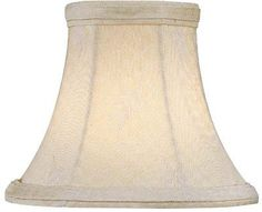 """Lite Source CH5130-5 Candelabra Shade, Leaf Jacquard by Lite Source Inc. $14.00. From the Manufacturer                This unique lamp shade will add flare to your home or office. The material is a soft white fabric, perfect for complimenting warm and coolhued areas. Although subtle, there is an intricate leaf detail in this shades jacquard fabric.                                    Product Description                CH5130-5 Size: 3"""" T x 5"""" B x 4"""" SL Features: -Candelabr..."""