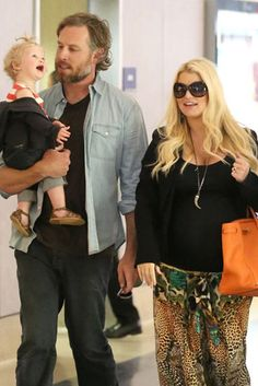They're back! Jessica Simpson, Eric Johnson, and their daughter, Maxwell, at LAX.