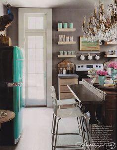 love the turqoise fridge and the gray walls