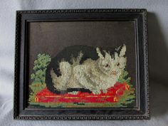 A very charming antique antique sampler or needlepoint depicting a kitten, cat. The sampler is worked in wool on a wool felt background, it looks Cross Stitch Samplers, Cross Stitching, Star Rug, Needlepoint Kits, Vintage Frames, Kitten, Kitty Cats, Cat Art, Folk Art