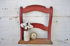 Painted red and attached to a piece of wood, this distressed chair back was given new life as a small shelf. Learn more at Knick of Time.   - CountryLiving.com