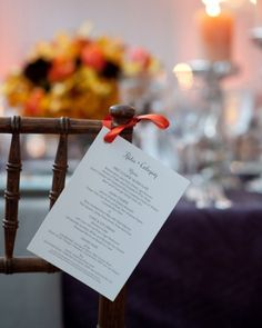 Cute idea!  Menu cards tied to the ears of the Chiavari chairs!  I love this!