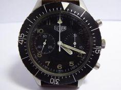 HEUER Montre Bundeswehr. Montre chronomètre de l'armée allemande. Chrono 2 compteurs. Cadran et lunette noirs. Fly back. Mouvement mécanique. Rare. Diamètre: 42 mm.  Garantie 1 an.