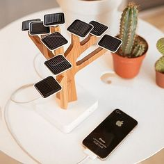 The Solar Suntree is a solar-powered charger for your mobile phone, iPod and other devices #corporategifts