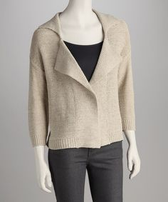 Baby, it's cold outside, but that doesn't mean style has to stray! Crafted with a blazer-style collar, this open cardigan features a comfortable, cozy feel that will have frosty style mavens begging for fashion tips.65% acrylic / 35% nylonHand wash; dry flatImported