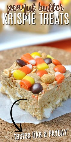 Chewy Peanut Butter Krispie treats topped with Candy Corn, Peanuts, and Reese's Pieces. This adaption of everyone's favorite childhood treat is here just in time for Halloween!