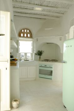 Loving this minimalist kitchen from a house in Greece.