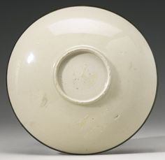 Lot 104| Sotheby's. A RARE 'DING' DISH SONG DYNASTY. BASE VIEW.