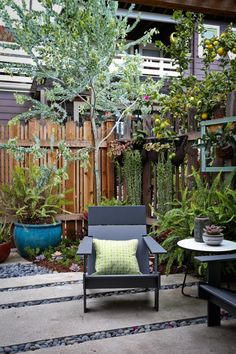 LA Garage turned cottage Outbuilding ; Gardenista Loll Lollygager chair...other colors