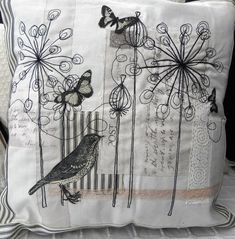 Embroidered and appliqued covered cushion with bird and butterflies. £17.50