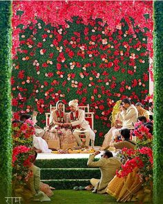 Looking for Floral wall unique mandap in red and green? Browse of latest bridal photos, lehenga & jewelry designs, decor ideas, etc. Wedding Hall Decorations, Marriage Decoration, Engagement Decorations, Backdrop Decorations, Flower Decorations, Backdrops, Backdrop Ideas, Decor Wedding, Wedding Mandap