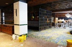 restaurant design | London | hotel interior design | decorative | perforated steel screens | William Morris inspired carpet | antique effect pressed metal ceiling | beveled green white metro tile