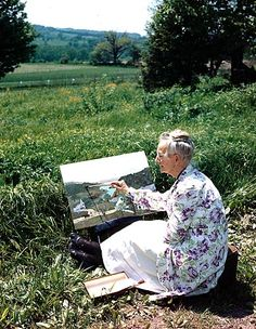 Grandma Moses painting in the field