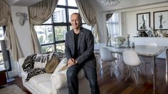 Craig Yelland, director of Plus Architecture, is a big advocate for apartment living. He is pictured in his Port Melbourne apartment, where has lived for five years with his wife and two children.